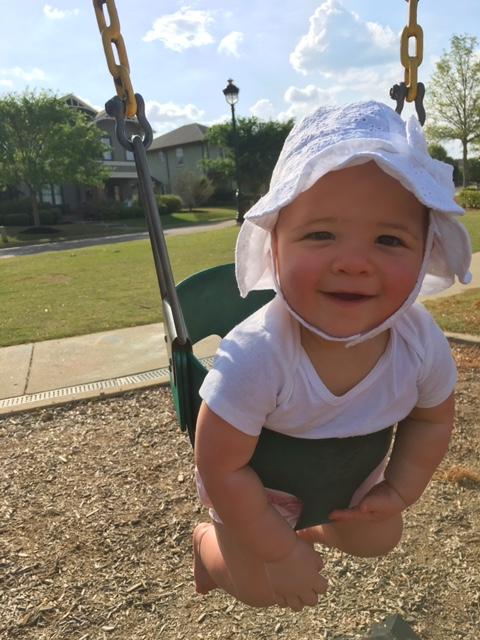 Multiple Children Mom Guilt - Ruthie in swing at park