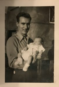 Long lost relatives - as a baby in his father's arms