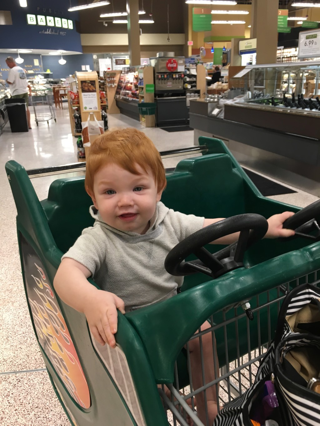 Grocery budgeting - distract the toddler so you don't end up with extra items in your cart!
