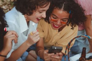 shallow-focus-photo-of-woman-using-game-boy-3491940