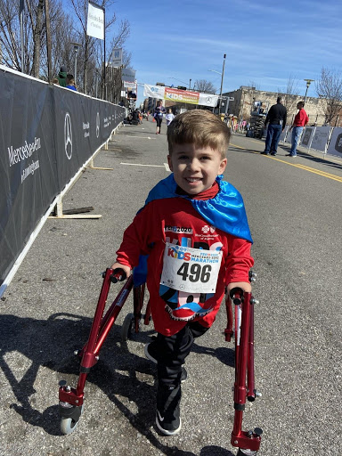 Spina bifida awareness - Andrew walks with the aid of a walker.